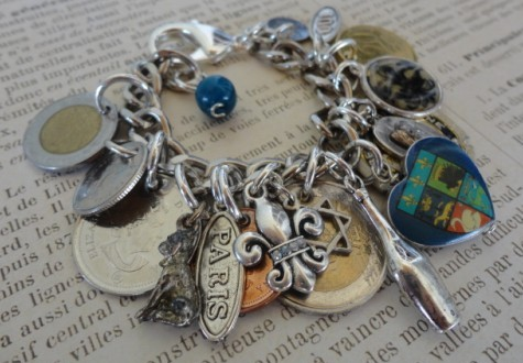 Charms & coins collected from her travels around the world.