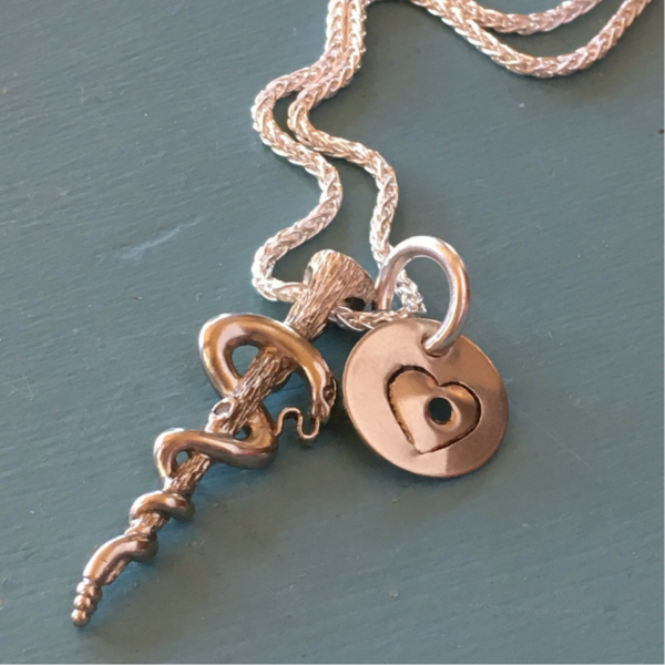 For Katie from Devin – The cadaceus pendant was created by Pat Burt from her mothers wedding ring.